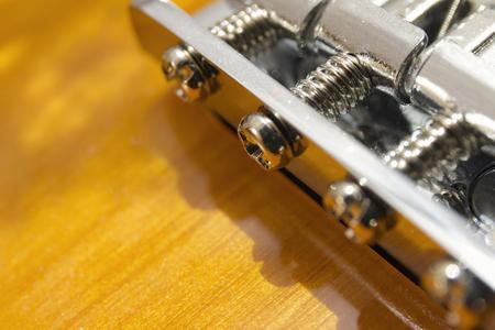 Electric sunburst guitar bridge close-up macro Stock Photo