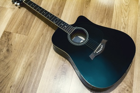 black acoustic guitar, contrast black and brown Stock Photo