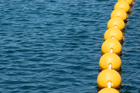 String of Buoys Floating on Ocean Surface