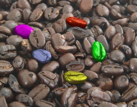 Playful colorful coffee beans on coffee bean background Stock Photo