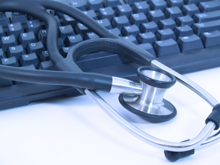 Picture of Stethoscope next to computer keyboard - blue Stock Photo - 1447699
