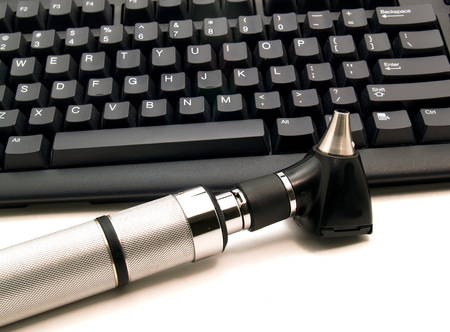 Picture of Otoscope next to computer keyboard