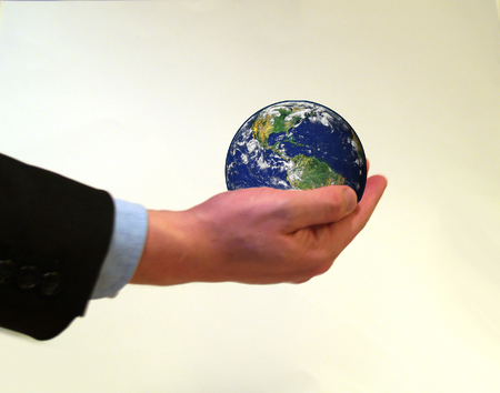 Businessman holding planet earth in his hand Stock Photo