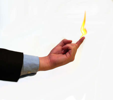 Businessman balancing a flame on his finger