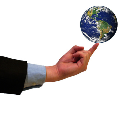 Businessman balancing planet earth on his finger