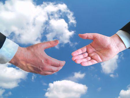 two businessmen shaking hands on blue sky background