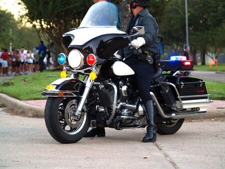 Police officer sitting on Motorcycle - side view photo