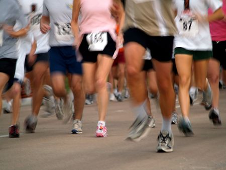 in distance: Runners in a long distance race - marathon Stock Photo