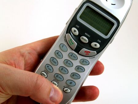 Cordless phone held in hand