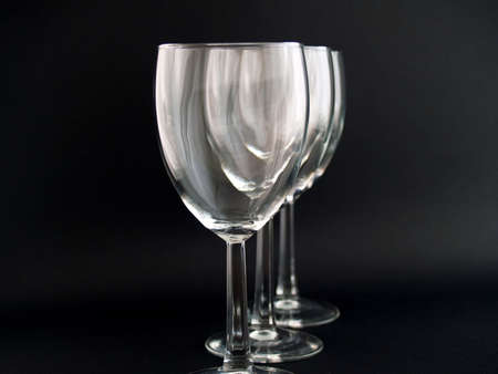 Three Wine Glasses on a black background