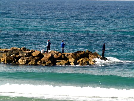 Gruppo di uomini di pesca in mare Archivio Fotografico - 2299987