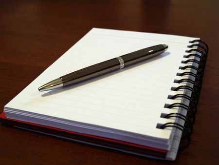 Open notebook with pen on top of it Stock Photo - 2458335