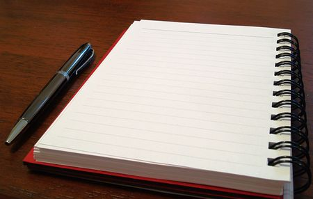 Open notebook with pen next to it