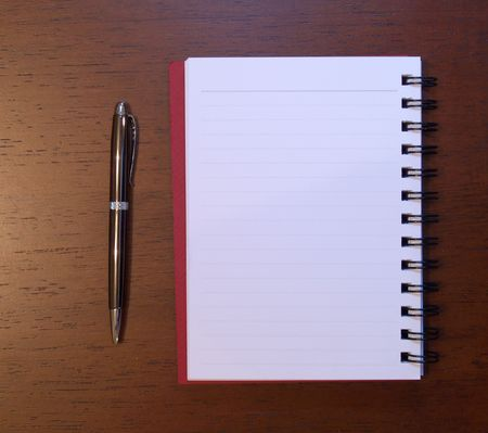 Open notebook with pen next to it photo