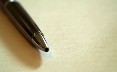 Close up Tip of elegant pen on an open notebook Stock Photo - 2458332