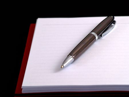pen on notebook on black Stock Photo - 2492115