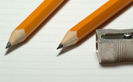 Image of two pencils with sharpener next to them - 1
