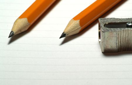 Image of two pencils with sharpener next to them - 2