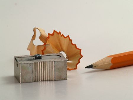 Image of pencil with sharpener and shavings next to it - 1