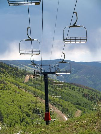 Ski chair Lift with mountains in background -1