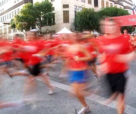 Runners in a long distance race - marathon Stock Photo