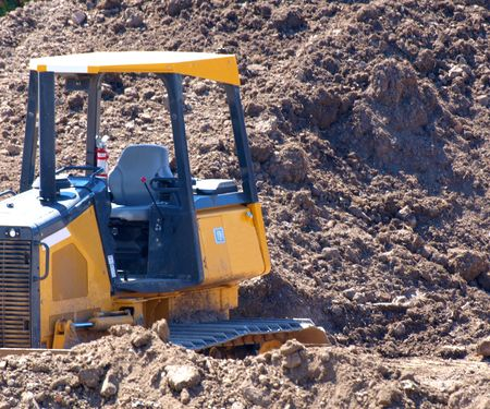 Large yellow bulldozer in construction site