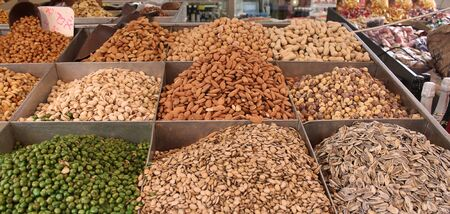 Photo of different kinds of nuts in a street market