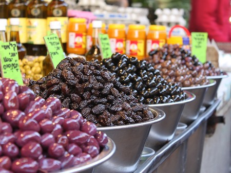 Green black and red olives on display in a Mediterranean market