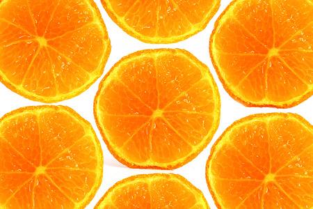 punctuality: rodajas de naranja en frente de fondo blanco Foto de archivo