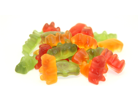 children eating: Gummi bears isolated