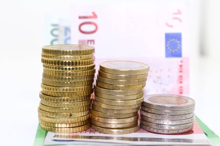 currency glitter: Euro banknotes and coins