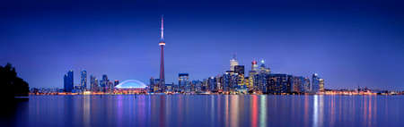 building cn tower: Wide view of the Toronto Skyline at dusk. It took 6 pictures to compose the final image.