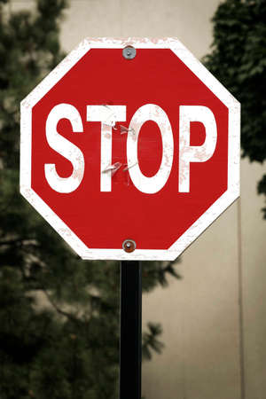 Stop sign with grungy background