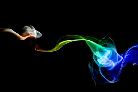 multicolored smoke of pink and red colors on a black isolated background. blur stock image