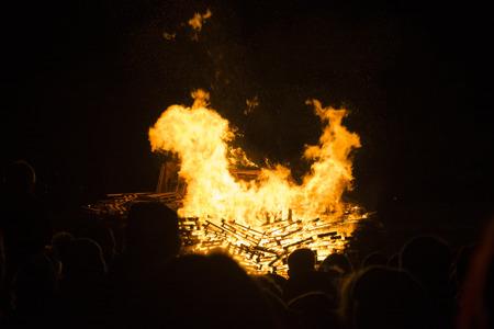 siloette: People watching bonfire glow Stock Photo