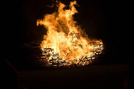 siloette: Burning crates bonfire Stock Photo