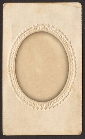 Antique card picture frame with blank photograph. Path included for oval. Stock Photo