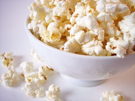 Popcorn in white bowl photo