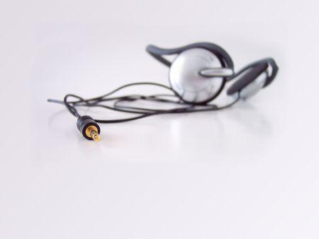 Headphones, taken in natural light. Short depth of field, focus set on jack tip. Stock Photo