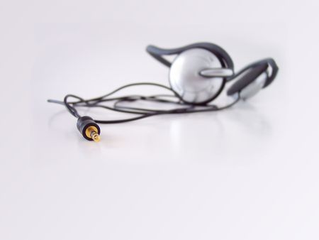 Headphones, taken in natural light. Short depth of field, focus set on jack tip. photo