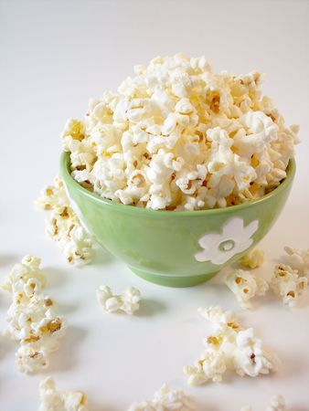 bowl of popcorn: Popcorn in a green bowl