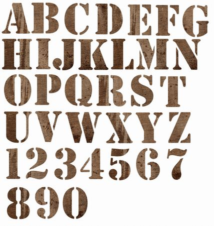 Alphabet and numbers cut from stained burlap. Stockfoto