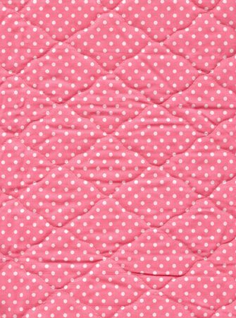 bedspread: Close up of pink quilt.