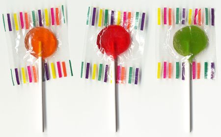 Three lollypops on white.