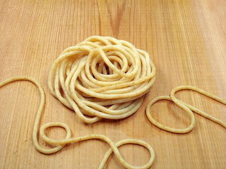 Cooked whole wheat pasta on cedar board