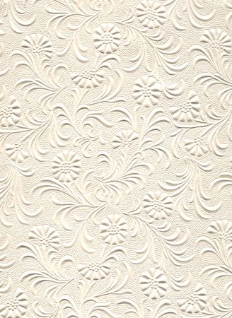 Close up of embossed flower pattern on paper.