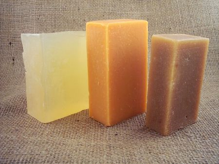 3 bars of natural soap - goat milk, hemp seed oil and glycerine, on a burlap background