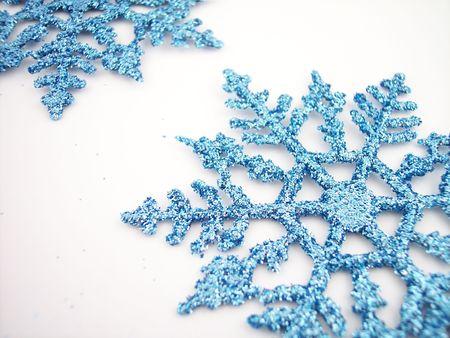 Blue glittery snowflakes. Standard-Bild