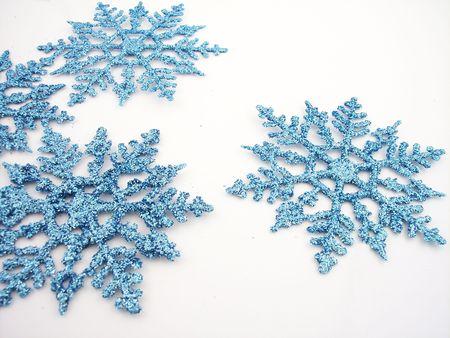 Blue glittery snowflakes. photo