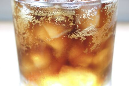 Soft Drink (cola) with ice. Very shallow DOF.